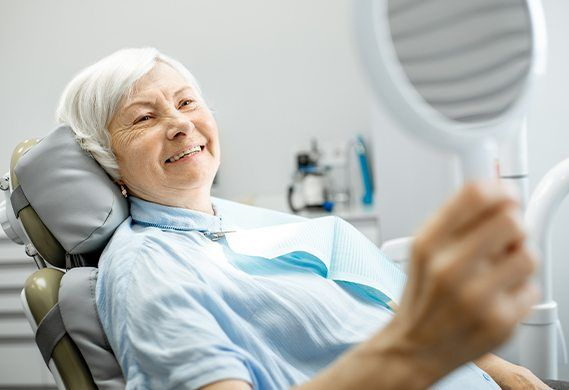 elderly woman smiling in exam chair