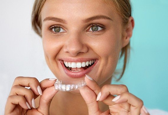girl putting in invisalign