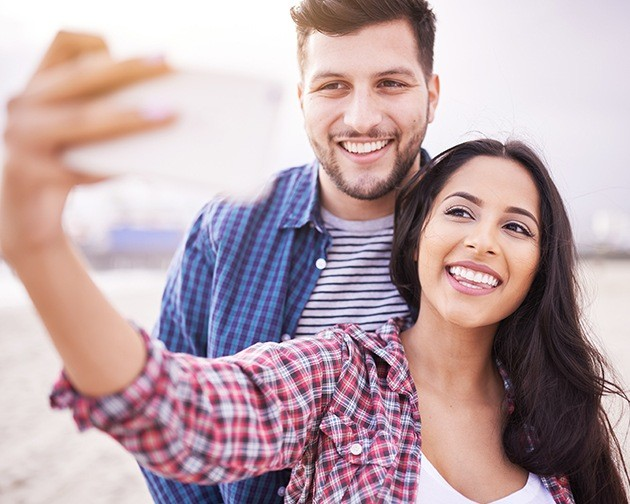 man and woman taking selfie