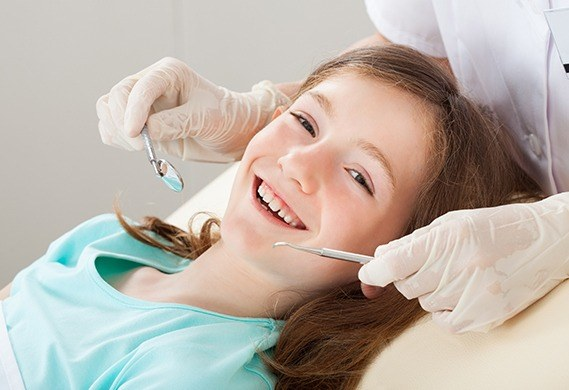 little girl getting dental cleaning