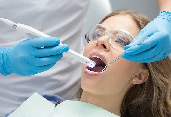 dentist using intraoral cameras