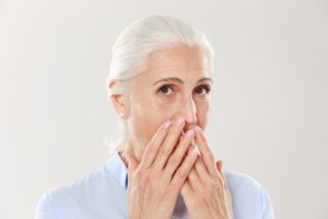 woman wants dental implants after tooth extraction